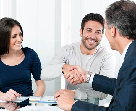 Happy Couple Reaching an Agreement with Businessman